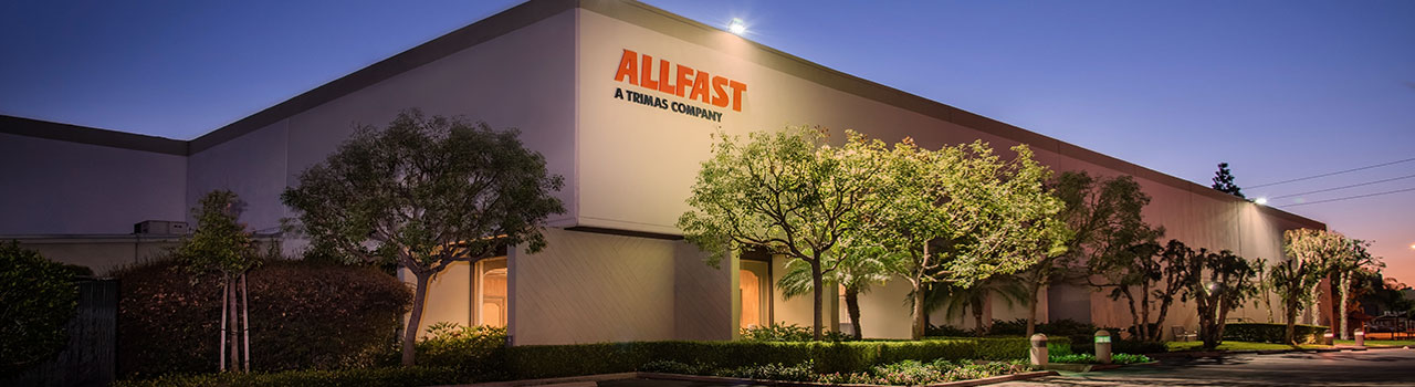 Allfast building exterior at night