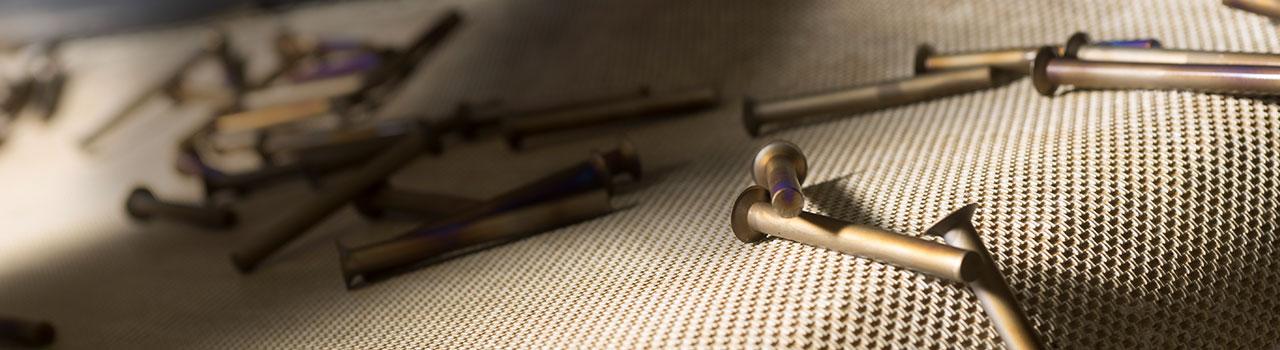 Metal Bolts on Fabric - Monogram Aerospace a Trimas Company